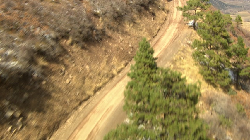 HD stock footage aerial video of following a road up a mountain slope in the Rocky Mountains, Colorado Aerial Stock Footage | HDA13_382_01