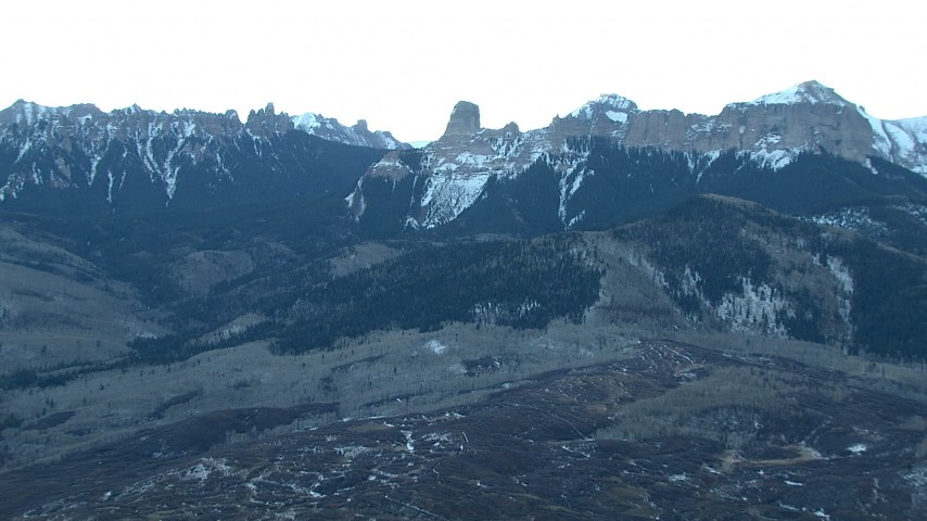 HD stock footage aerial video of the foothills and snow-capped Rocky Mountains at sunrise in Colorado Aerial Stock Footage HDA13_400 | Axiom Images