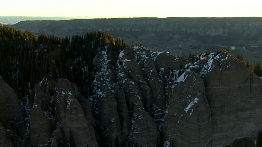 HD stock footage aerial video fly over a mountain ridge to reveal a valley at sunrise in the Rocky Mountains, Colorado Aerial Stock Footage | HDA13_403_04