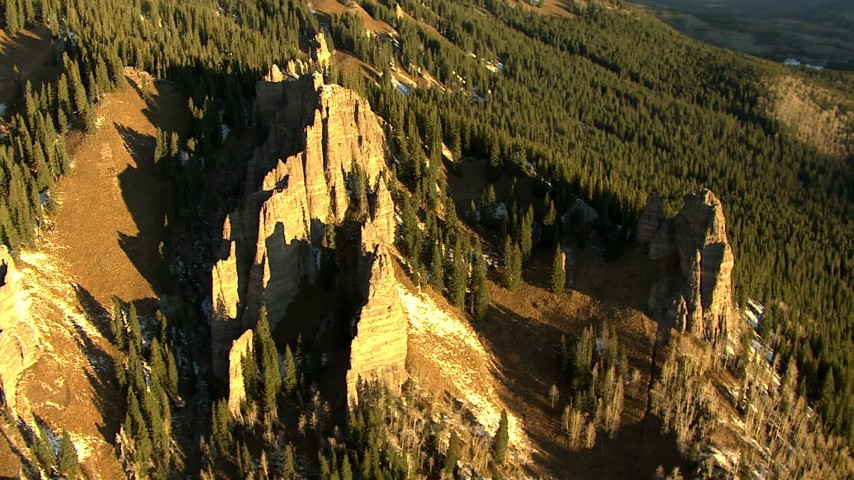 HD stock footage aerial video of rock formations on a mountain slope at sunrise in the Rocky Mountains, Colorado Aerial Stock Footage | HDA13_403_05