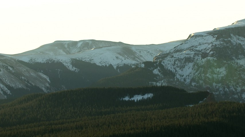 HD stock footage aerial video of flying by snow capped ridges at sunrise in the Rocky Mountains, Colorado Aerial Stock Footage | HDA13_405