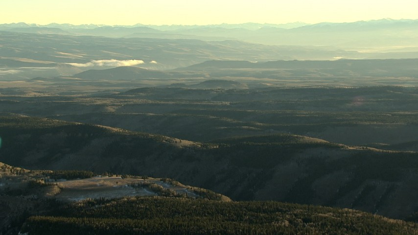 HD stock footage aerial video of mountain ridges with light snow at sunrise in the Rocky Mountains, Colorado Aerial Stock Footage | HDA13_407