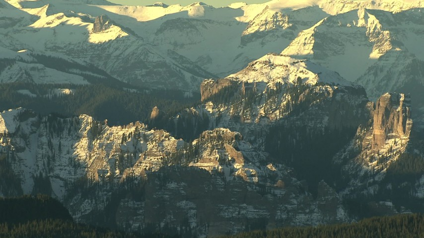 HD stock footage aerial video of steep and snowy mountains at sunrise, Rocky Mountains, Colorado Aerial Stock Footage | HDA13_409_01