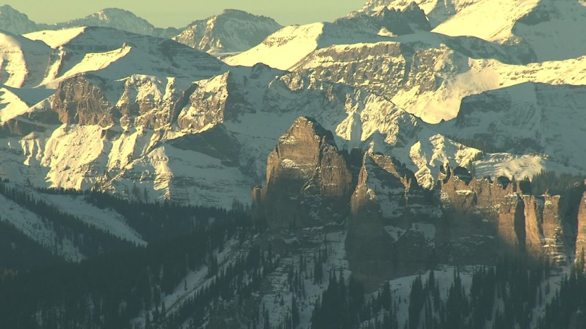HD stock footage aerial video of jagged peaks with snow at sunrise in the Rocky Mountains, Colorado Aerial Stock Footage | HDA13_410