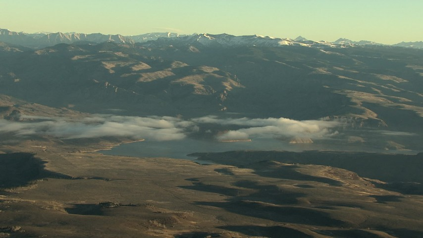 HD stock footage aerial video of the Blue Mesa Reservoir and Rocky Mountains at sunrise, Colorado Aerial Stock Footage | HDA13_412