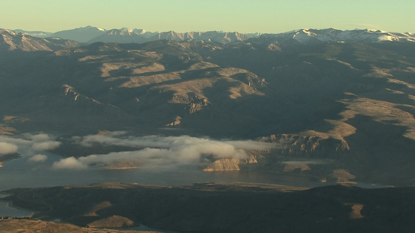 HD stock footage aerial video of the Blue Mesa Reservoir and the Rocky Mountains at sunrise, Colorado Aerial Stock Footage | HDA13_414