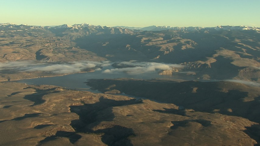 HD stock footage aerial video of a wide view of the Blue Mesa Reservoir and Rocky Mountains at sunrise, Colorado Aerial Stock Footage | HDA13_414_01