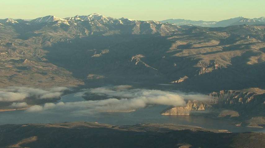 HD stock footage aerial video of the Blue Mesa Reservoir and the Rocky Mountains at sunrise, Colorado Aerial Stock Footage | HDA13_415