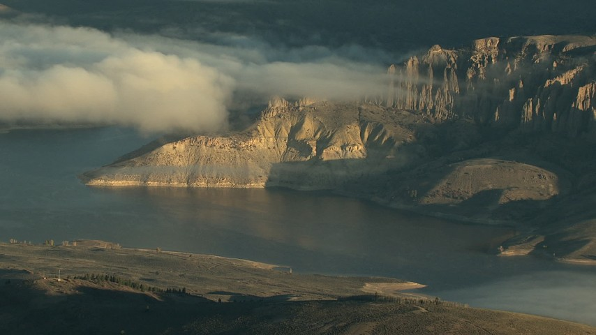 HD stock footage aerial video of low clouds over the Blue Mesa Reservoir at sunrise, Colorado Aerial Stock Footage | HDA13_415_01