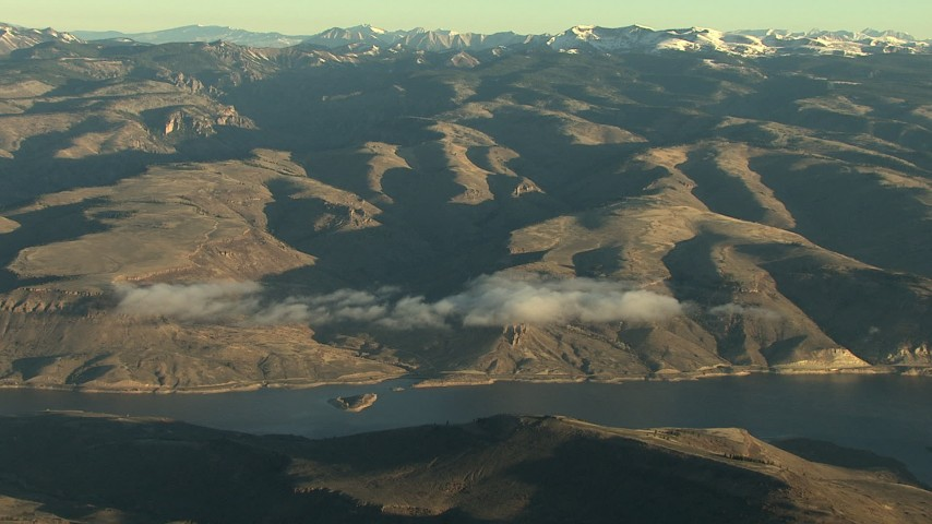 HD stock footage aerial video of flying by the Blue Mesa Reservoir and Rocky Mountains at sunrise, Colorado Aerial Stock Footage | HDA13_416