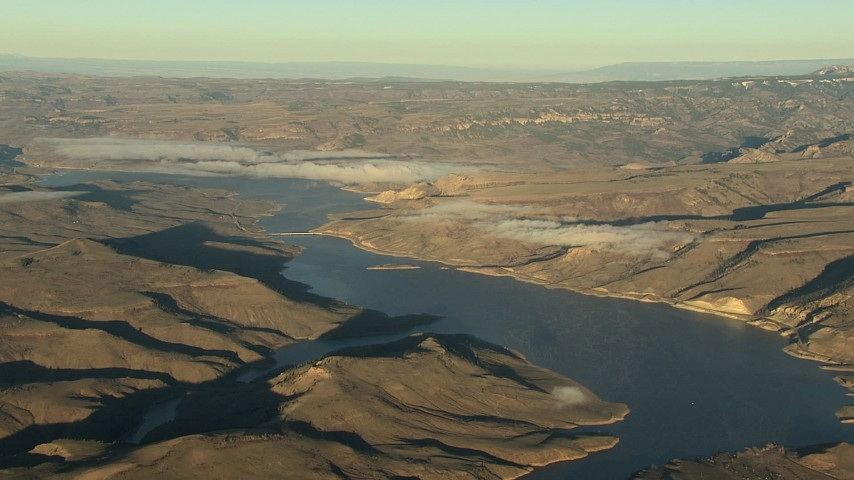 HD stock footage aerial video of the Blue Mesa Reservoir and Rocky Mountains at sunrise, Colorado Aerial Stock Footage | HDA13_419