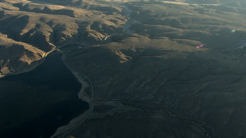 HD stock footage aerial video tilt from the Blue Mesa Reservoir at sunrise to reveal the town of Gunnison, Colorado Aerial Stock Footage | HDA13_421