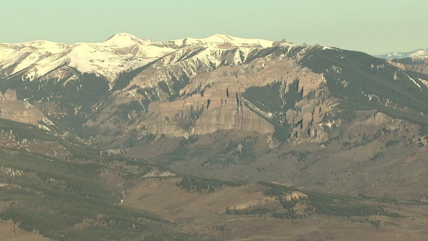 HD stock footage aerial video of tall mountains with snow at sunrise, Rocky Mountains, Colorado Aerial Stock Footage | HDA13_432