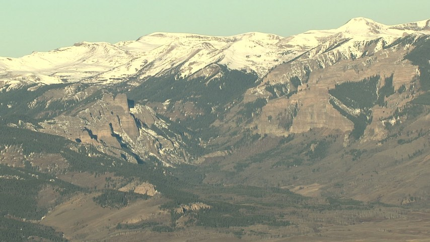HD stock footage aerial video of snow-capped Rocky Mountains at sunrise, Colorado Aerial Stock Footage | HDA13_435