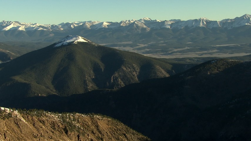 HD stock footage aerial video of panning across the snowy summits at sunrise, Rocky Mountains, Colorado Aerial Stock Footage | HDA13_440_02