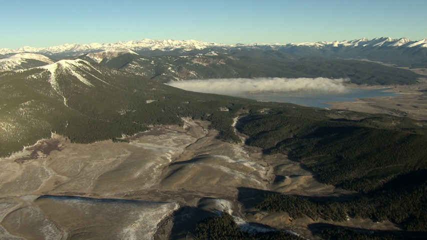 HD stock footage aerial video of a reservoir with fog at sunrise, surrounded by the Rocky Mountains, Colorado Aerial Stock Footage   HDA13_442