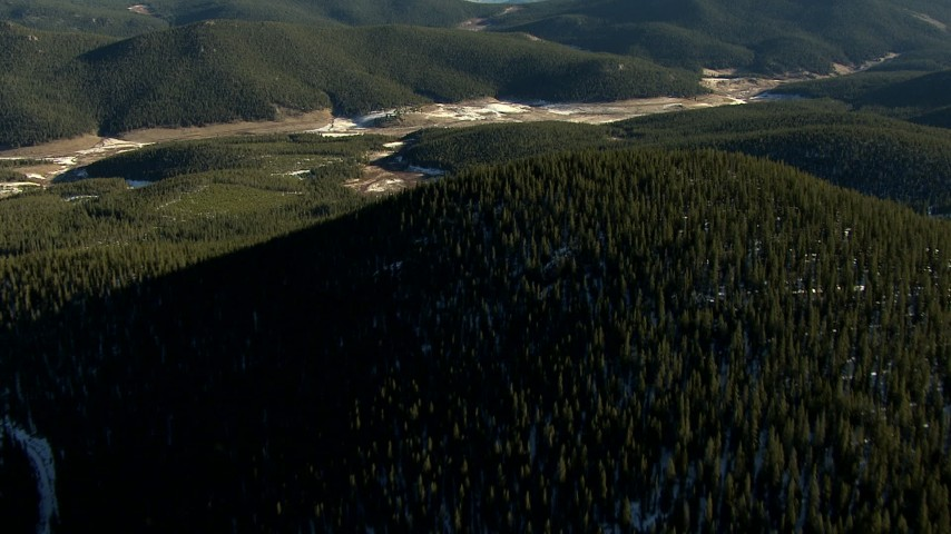HD stock footage aerial video of flying over evergreen trees on mountains with snow in the Rocky Mountains, Colorado Aerial Stock Footage | HDA13_474