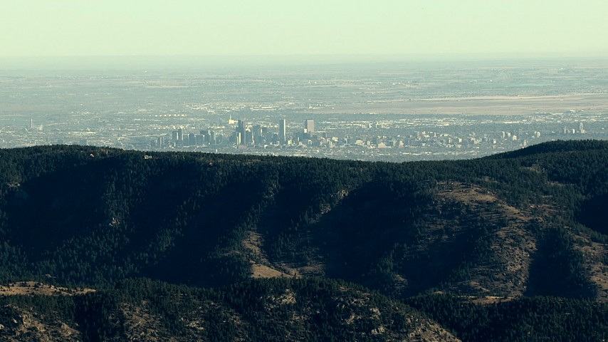 HD stock footage aerial video of the Denver skyline seen from a green ridge in the Rocky Mountains, Colorado Aerial Stock Footage | HDA13_480