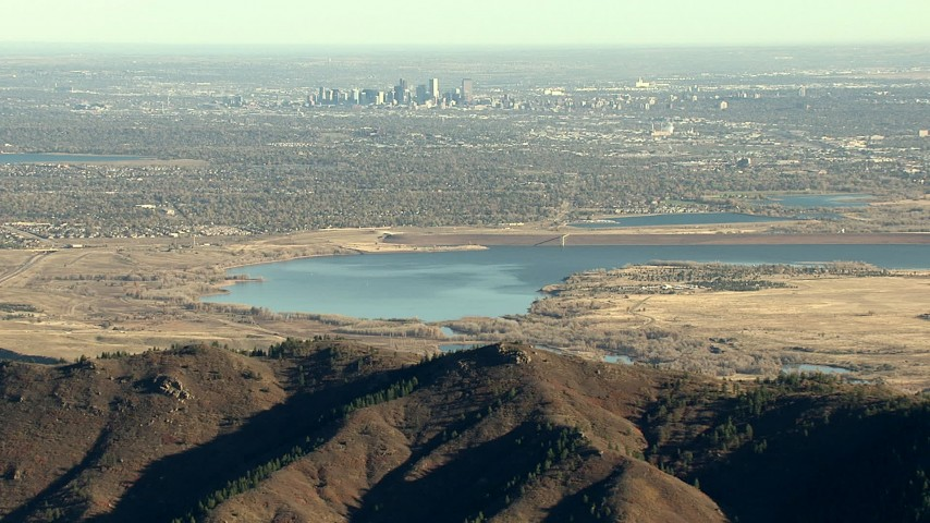 HD stock footage aerial video of the Downtown Denver skyline and reservoir seen from the Rocky Mountains, Colorado Aerial Stock Footage | HDA13_482_05