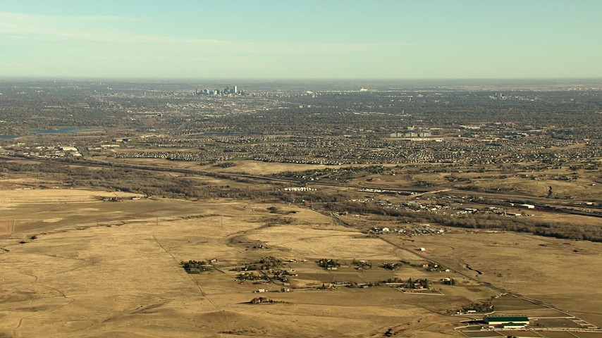 HD stock footage aerial video of the Downtown Denver skyline and surrounding suburbs in Colorado Aerial Stock Footage | HDA13_484