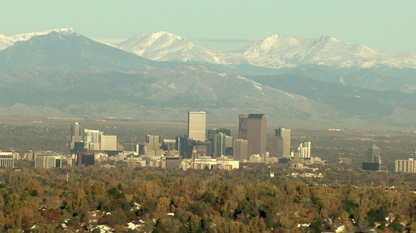HD stock footage aerial video of massive Rocky Mountains behind Downtown Denver, Colorado Aerial Stock Footage | HDA13_488_03
