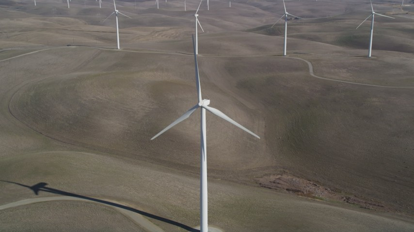 5K stock footage aerial video approach and track a Shiloh Wind Power Plant windmill, Montezuma Hills, California Aerial Stock Footage | JDC01_064