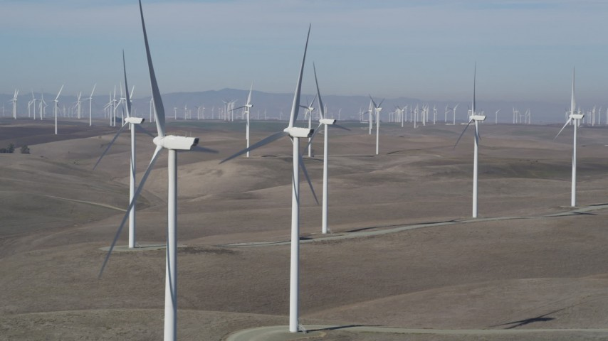 5K stock footage aerial video of flying by windmills at Shiloh Wind Power Plant, Montezuma Hills, California Aerial Stock Footage | JDC01_067