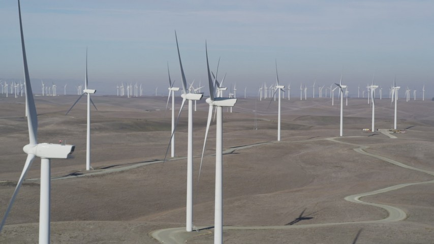 5K stock footage aerial video of flying by field of windmills, Shiloh Wind Power Plant, Montezuma Hills, California Aerial Stock Footage | JDC01_068