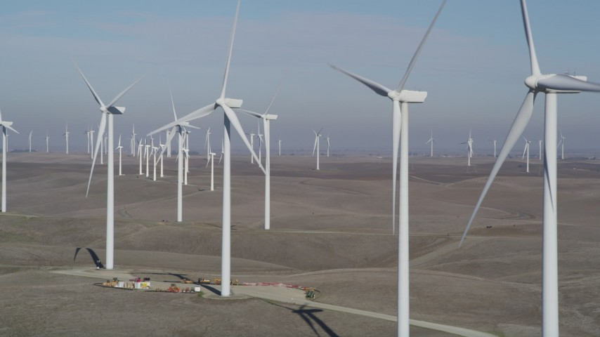 5K stock footage aerial video of flying by rows of windmills, Shiloh Wind Power Plant, Montezuma Hills, California Aerial Stock Footage | JDC01_073