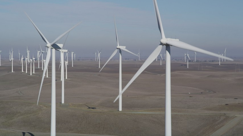 5K stock footage aerial video of flying by a row of windmills, Shiloh Wind Power Plant, Montezuma Hills, California Aerial Stock Footage | JDC01_074