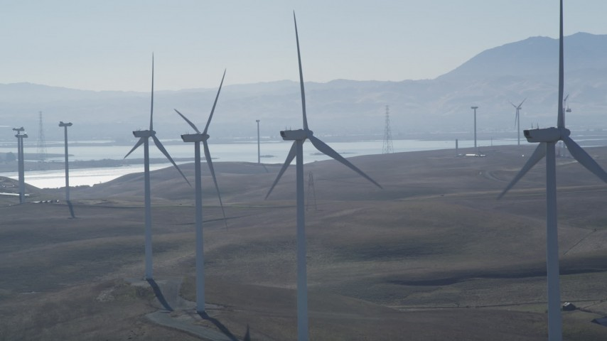 5K stock footage aerial video of flying by a row of windmills, Shiloh Wind Power Plant, Montezuma Hills, California Aerial Stock Footage | JDC01_075