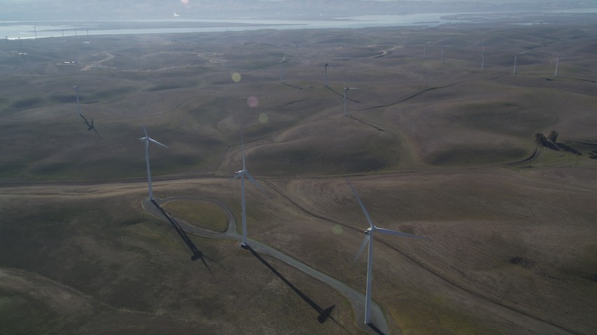 5K stock footage aerial video of flying by a row of windmills, Shiloh Wind Power Plant, Montezuma Hills, California Aerial Stock Footage | JDC01_077