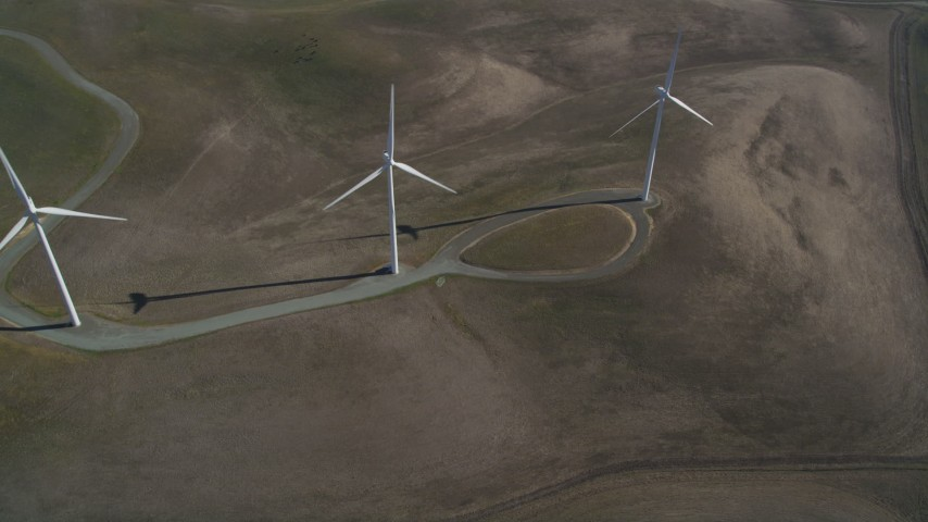 5K stock footage aerial video orbit three windmills on hill, Shiloh Wind Power Plant, Montezuma Hills, California Aerial Stock Footage | JDC01_079