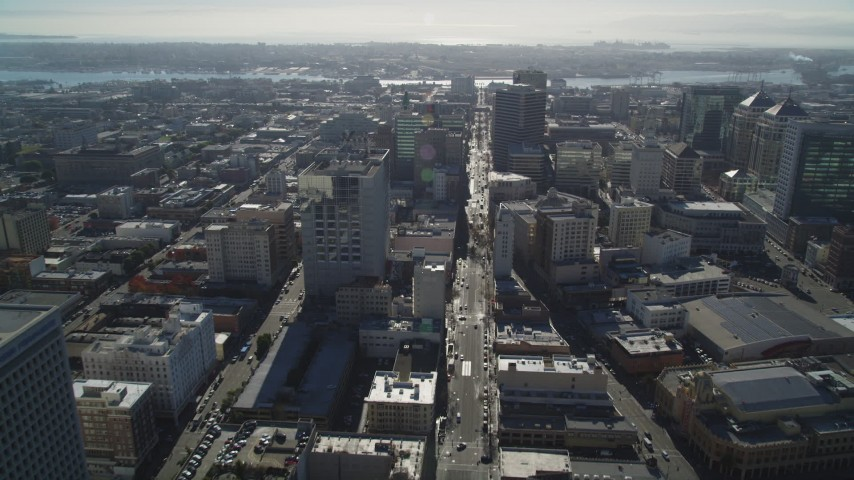 5K stock footage aerial video of following Broadway and tilt to wider view of office buildings, Downtown Oakland, California Aerial Stock Footage | JDC02_009