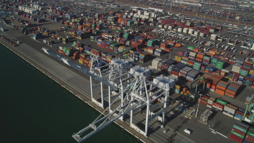 5K stock footage aerial video of flying by shipping containers, cargo cranes at Port of Oakland, California Aerial Stock Footage | JDC02_011