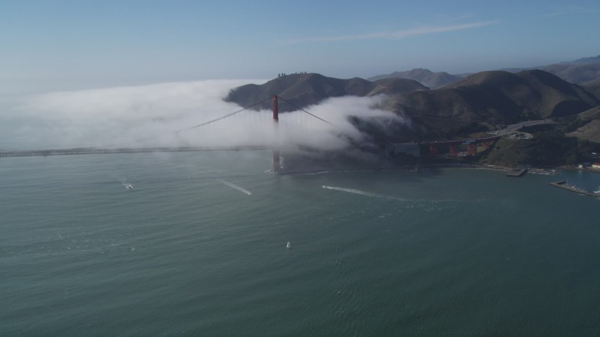 5K stock footage aerial video of of the Marin Hills and famous Golden Gate Bridge, shrouded in fog, San Francisco, California Aerial Stock Footage | JDC02_012