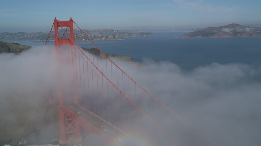 5K stock footage aerial video of orbiting the famous Golden Gate Bridge, shrouded in fog, San Francisco, California Aerial Stock Footage | JDC02_013