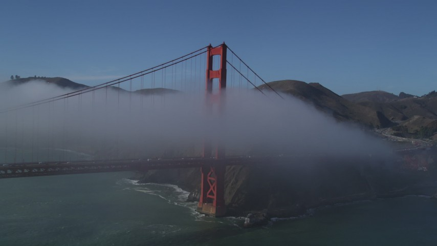 5K stock footage aerial video of orbiting the iconic Golden Gate Bridge, shrouded in fog, San Francisco, California Aerial Stock Footage | JDC02_014