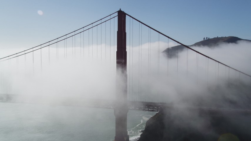 5K stock footage aerial video of flying by the iconic Golden Gate Bridge, shrouded in thick fog, San Francisco, California Aerial Stock Footage | JDC02_015