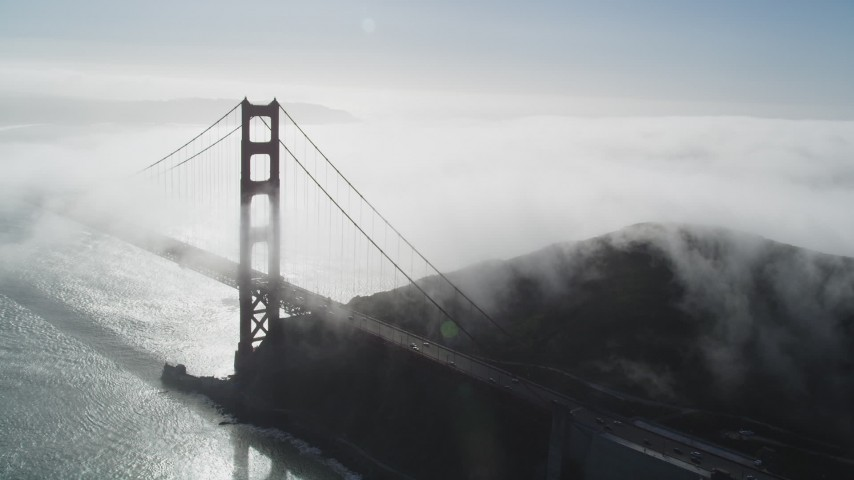 5K aerial video of an orbit of thick fog rolling over Golden Gate Bridge, San Francisco, California Aerial Stock Footage | JDC02_018