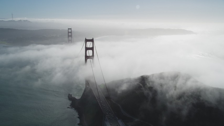5K stock footage aerial video of flying by thick fog rolling over the historic Golden Gate Bridge, San Francisco, California Aerial Stock Footage JDC02_019 | Axiom Images