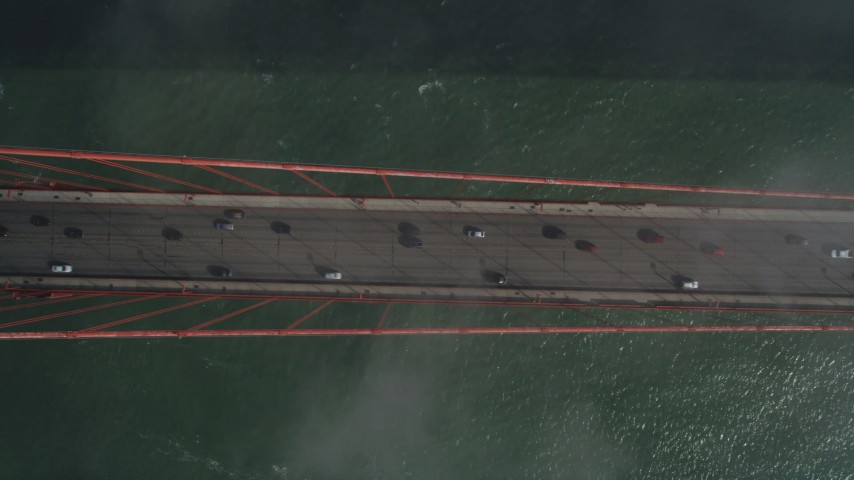 Bird's eye view over light traffic on Golden Gate Bridge, San Francisco, California Aerial Stock Footage | JDC02_023