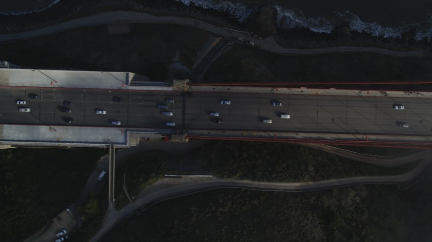 5K stock footage aerial video of a bird's eye view over traffic, fog on Golden Gate Bridge, San Francisco, California Aerial Stock Footage | JDC02_024