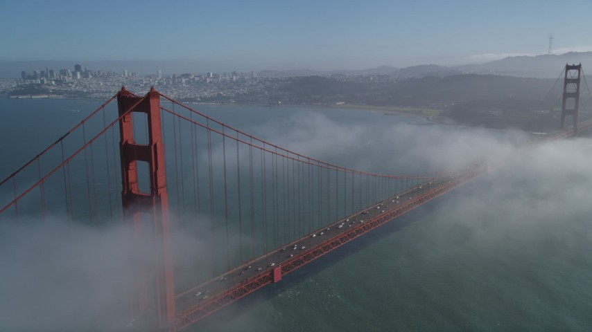 5K stock footage aerial video fly over Marin Hills, reveal famous and iconic Golden Gate Bridge in fog, San Francisco, California Aerial Stock Footage | JDC02_025