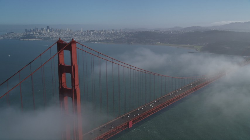 5K stock footage aerial video approach the city while flying over the Golden Gate Bridge, Downtown San Francisco, California Aerial Stock Footage JDC02_026 | Axiom Images