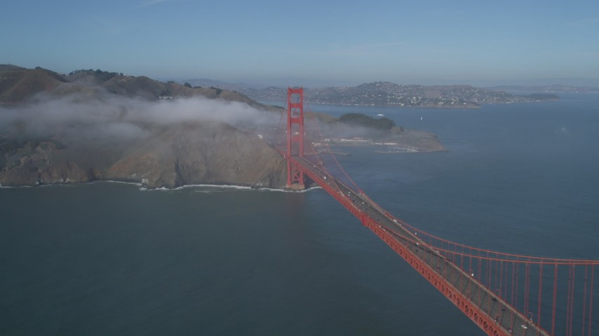 5K stock footage aerial video of flying by the world famous Golden Gate Bridge with light fog, San Francisco, California Aerial Stock Footage | JDC02_027
