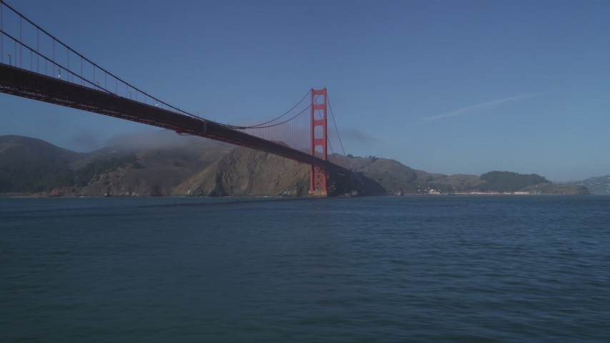 5K stock footage aerial video of flying low over the Bay, under the iconic Golden Gate Bridge, San Francisco, California Aerial Stock Footage | JDC02_030