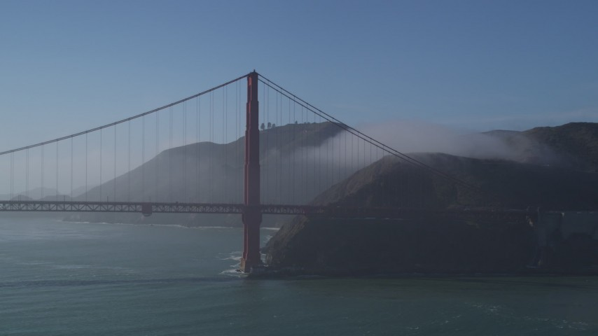 5K stock footage aerial video of flying by the Golden Gate Bridge, light fog, San Francisco, California Aerial Stock Footage | JDC02_031