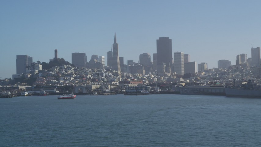 5K stock footage aerial video of Fisherman's Wharf and city skyline seen from the bay, Downtown San Francisco, California Aerial Stock Footage | JDC02_037