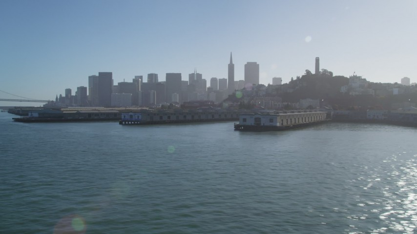 5K stock footage aerial video of flying by Coit Tower and the city skyline, seen from the Bay, Downtown San Francisco, California Aerial Stock Footage | JDC02_039